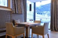 Sunnsait Lounge mit Blick auf die Piste - Appartements in Maria Alm